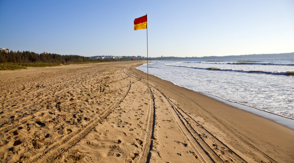 Flag on the beach, Miramar Beach, Panjim, Goa, India