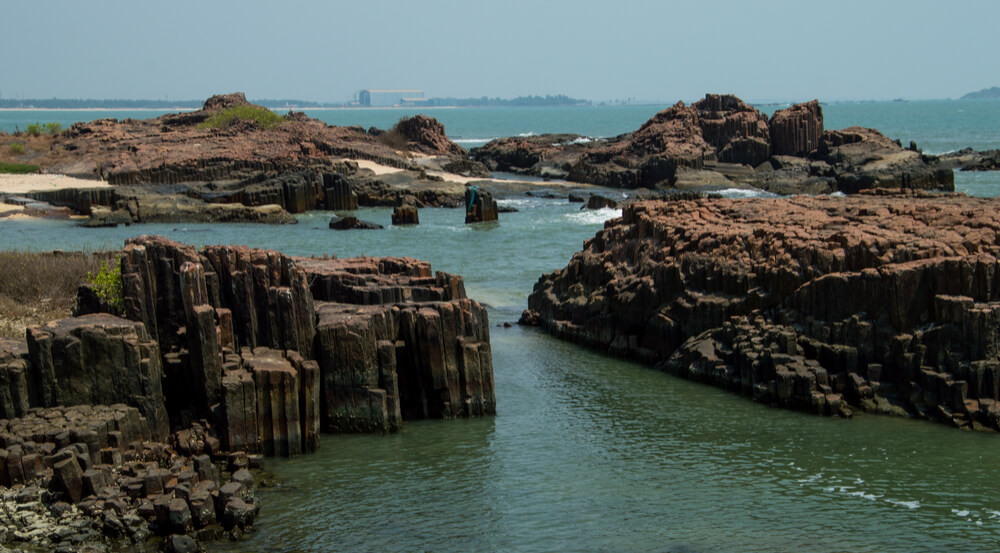 Landscape of St. Mary's island in Mangalore, India with basaltic columnar geological texture