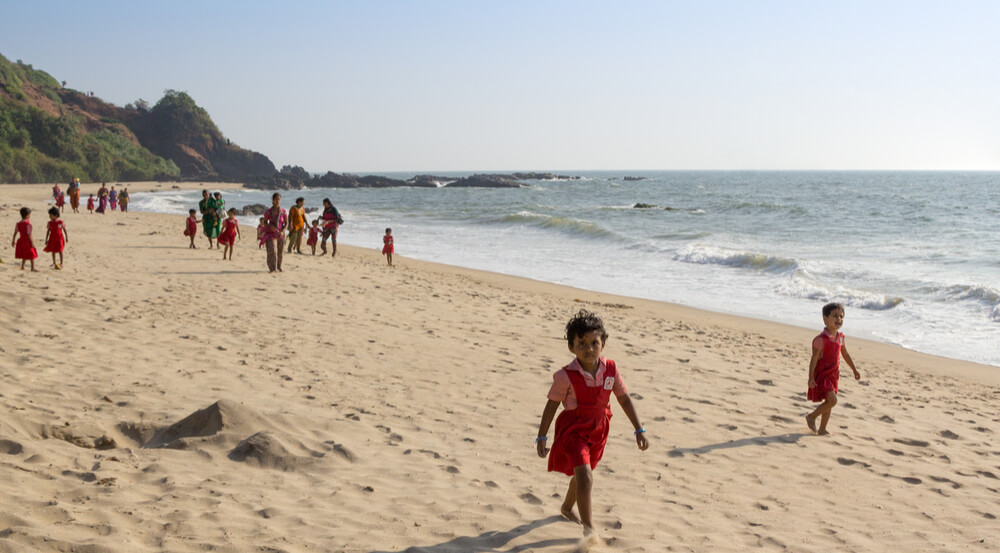 Unidentified children play on the beach in Goa, India