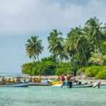 Kalpeni Island, Arabian Ocean, tourists engage in water sports in blue sea of tropical island