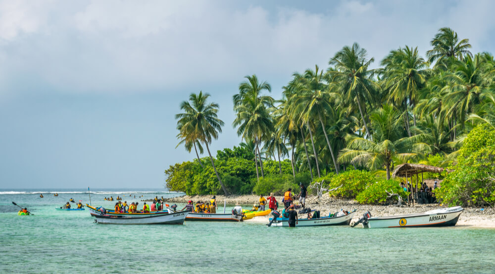 Kalpeni Island, Lakshadweep - Arabian Ocean, tourists engage in water sports in blue sea of tropical island