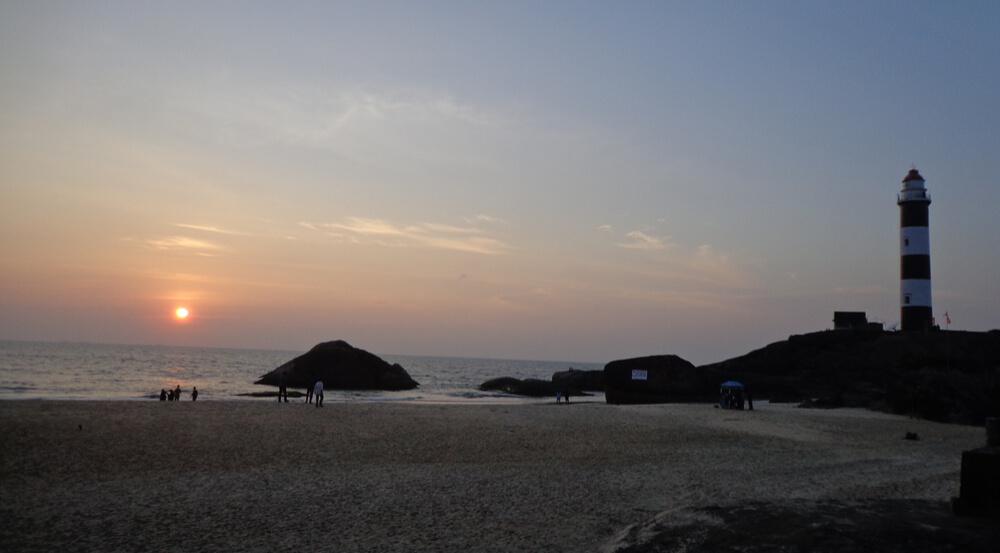 Sunset and the light house at Kapu beach, Karnataka India