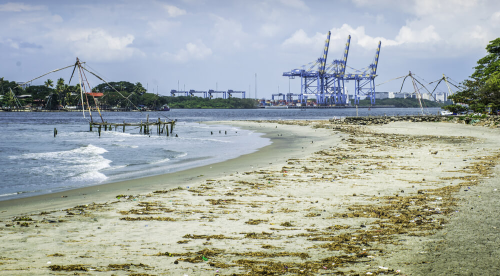 Fort Kochi tropical beach with heavy industry in background