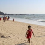 Children play on the beach in Goa, India