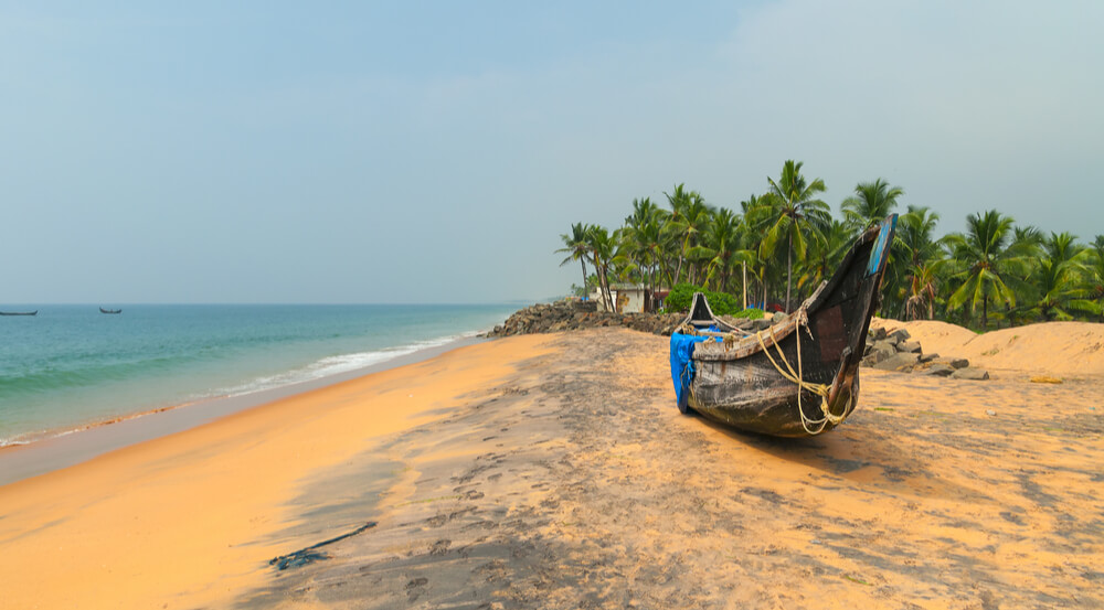 Fishing Boat on Tropical beach in Kovalam, Kerala, India