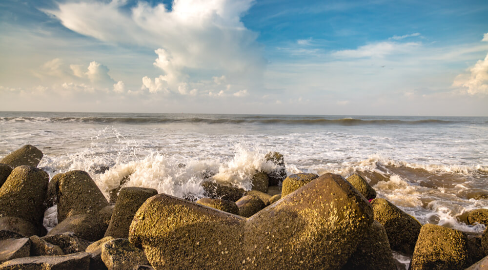 Sea waves splashing against the beach rocks at Digha beach, West Bengal, India